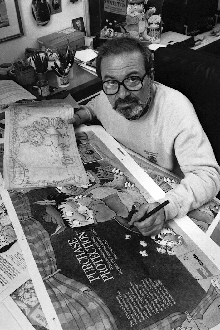 """FILE - In this October 1988 file photo, author Maurice Sendak, creator of the best-selling children's book """"Where the Wild Things Are,"""" checks proofs of art for a major advertising campaign in his Ridgefield, Conn., home. Sendak died, Tuesday, May 8, 2012 at Danbury Hospital in Danbury, Conn. He was 83. (AP Photo, file)"""