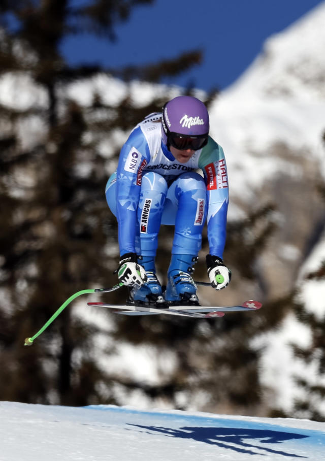 First placed Tina Maze, of Slovenia, speeds down the course during an alpine ski World Cup women's downhill in Cortina D' Ampezzo, Italy, Saturday, Jan. 25, 2014. (AP Photo/Marco Trovati)