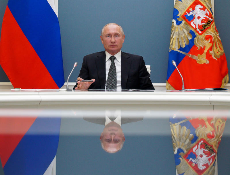 Russian President Vladimir Putin attends a video call with Defense Minister Sergei Shoigu in Moscow, Russia, Tuesday, June 30, 2020. Shoigu reported to Putin that the Defense Ministry plans to complete clinical tests of a coronavirus vaccine next month. (Alexei Druzhinin, Sputnik, Kremlin Pool Photo via AP)
