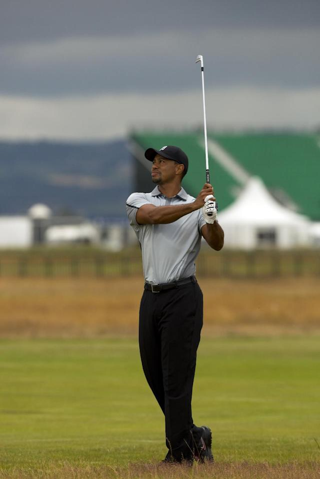 Tiger Woods of the US walks plays a shot on the 2nd fairway during a practice round at Royal Liverpool Golf Club prior to the start of the British Open Golf Championship, in Hoylake, England, Saturday, July 12, 2014. The 2014 Open Championship starts on Thursday July 17. (AP Photo/Jon Super)