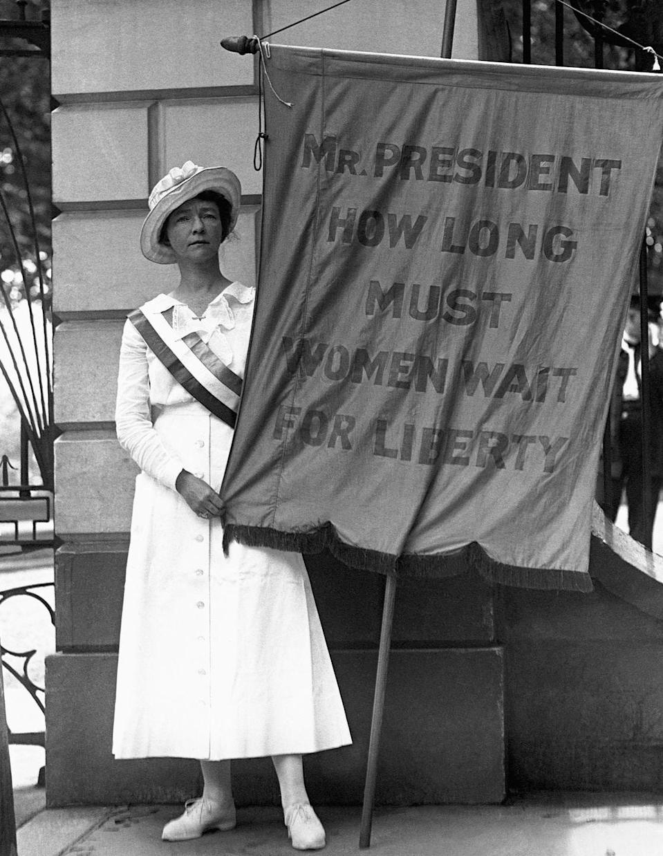 """<p>A woman identified as Mrs. William L. Colt picketed the White House in a series of protests for women's suffrage. In the early 1910s, protests organized by Alice Paul, Lucy Burns, and the National American Woman Suffrage Association (NAWSA) erupted in Washington the day before President Woodrow Wilson's inauguration. The group's message was to """"march in a spirit of protest against the present political organization of society, from which women are excluded.""""</p>"""