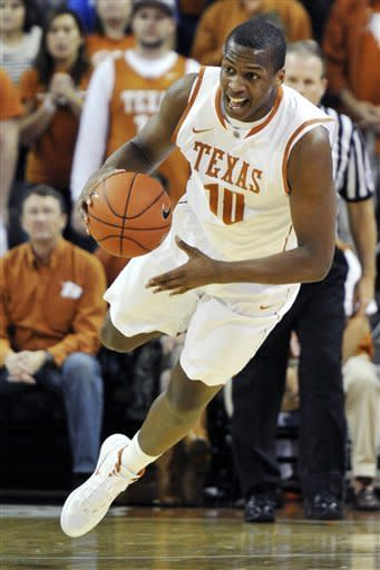 Texas forward Jonathan Holmes dives for the loose ball against Missouri during the first half of an NCAA college basketball game, Monday, Jan. 30, 2012, in Austin, Texas. (AP Photo/Michael Thomas)
