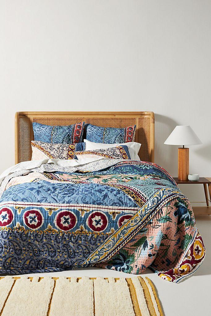 """<p><strong>Artisan Quilts by Anthropologie</strong></p><p>anthropologie.com</p><p><strong>$248.00</strong></p><p><a href=""""https://go.redirectingat.com?id=74968X1596630&url=https%3A%2F%2Fwww.anthropologie.com%2Fshop%2Fkantha-stitched-katya-quilt&sref=https%3A%2F%2Fwww.townandcountrymag.com%2Fleisure%2Fg37191699%2Ffall-bedroom-decor%2F"""" rel=""""nofollow noopener"""" target=""""_blank"""" data-ylk=""""slk:Shop Now"""" class=""""link rapid-noclick-resp"""">Shop Now</a></p><p>If you're not ready to completely give up that summer-quilt feeling, try swapping yours for one with a more seasonal color palette. This one from Anthropologie offers a <a href=""""https://www.elledecor.com/design-decorate/room-ideas/g10241076/bohemian-room-decor/"""" rel=""""nofollow noopener"""" target=""""_blank"""" data-ylk=""""slk:boho print"""" class=""""link rapid-noclick-resp"""">boho print</a> in vibrant fall hues. </p>"""