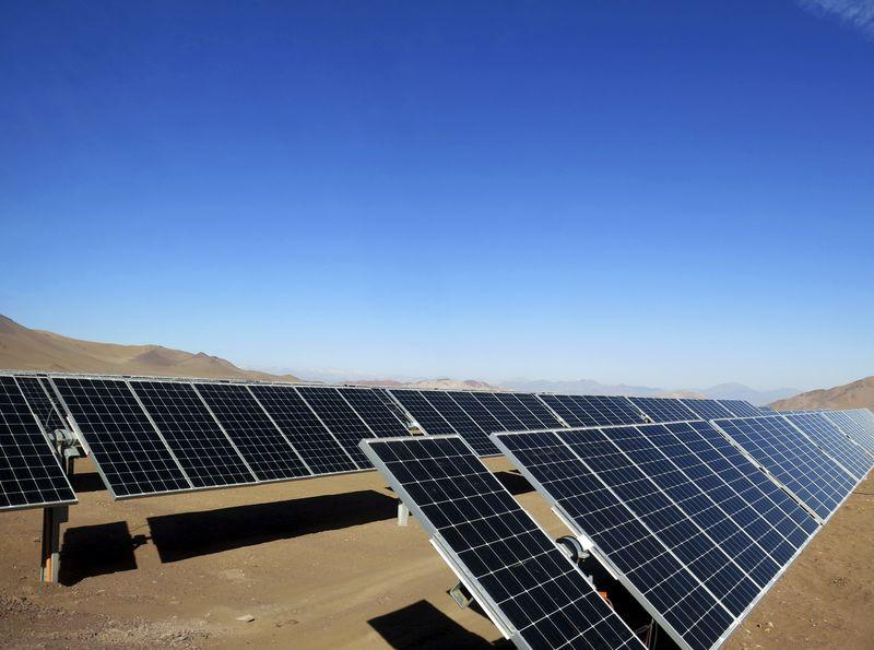 File photo of solar panels of local mining company CAP seen in the Atacama Desert