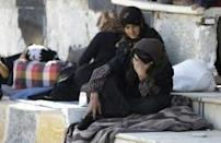 For families fleeing IS, a waystation in Aleppo