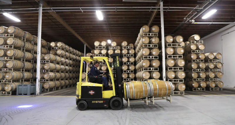 In this photo taken Thursday, Nov. 21, 2019, barrels of wine are moved into storage at Chateau Ste. Michelle winery in Woodinville, Wash. From less than 20 wineries in 1981, the Washington wine industry has grown to more than 1,000 this year. And the growth is likely to continue. (AP Photo/Elaine Thompson)