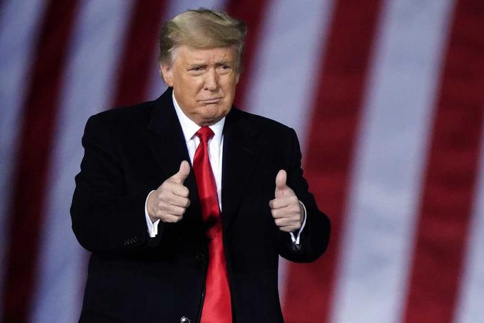 President Donald Trump arrives to speak at a campaign rally in support of Senate candidates Sen. Kelly Loeffler, R-Ga., and David Perdue in Dalton, Ga., Monday, Jan. 4, 2021. (AP Photo/Brynn Anderson)