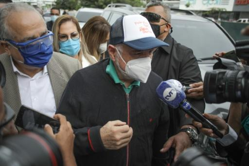 Former Panama president Ricardo Martinelli is surrounded by reporters as he arrives at the prosecutor's office in Panama City