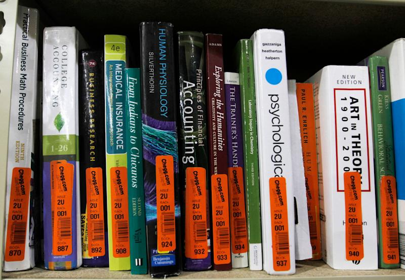 Textbooks sit on a shelf at the Chegg Inc. warehouse in Shepherdsville, Kentucky, U.S., on Thursday, April 29, 2010. No more $120 chemistry books. That's the message from textbook-rental service Chegg Inc., which is urging college students to stop paying top dollar to buy their tomes. Photographer: John Sommers II/Bloomberg via Getty Images