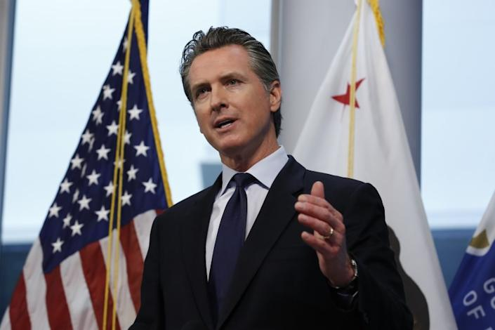 """Gov. Gavin Newsom updates the state's response to the coronavirus, at the Governor's Office of Emergency Services in Rancho Cordova, on March 30, 2020. Newsom announced the state is enlisting retired doctors and medical and nursing students to help treat an anticipated surge of coronavirus patients. <span class=""""copyright"""">(Rich Pedroncelli / Associated Press)</span>"""
