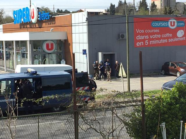 <p>Police are seen at the scene of a hostage situation in a supermarket in Trèbes, Aude, France March 23, 2018 in this picture obtained from a social media video. (Photo: La Vie a Trebes/via Reuters) </p>