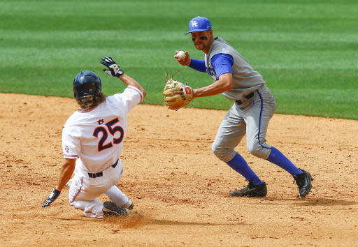Kentucky infielder Trey Dawson (2) throws to first for the double play as Auburn outfielder Jay Estes (25) slides into second base during the fourth inning of a Southeastern Conference NCAA college baseball game, Tuesday, May 22, 2018, in Hoover, Ala. (AP Photo/Butch Dill)