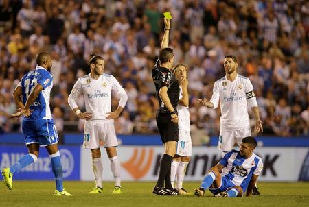 Soccer Football - La Liga - Deportivo de la Coruna vs Real Madrid - A Coruna, Spain - August 20, 2017   Real Madrid's Sergio Ramos receives a yellow card   REUTERS/Miguel Vidal