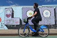 Bicycles in New York are helping medical workers commute to hospitals, migrant workers deliver takeouts and cooped-up residents escape their cramped apartments (AFP Photo/Angela Weiss)