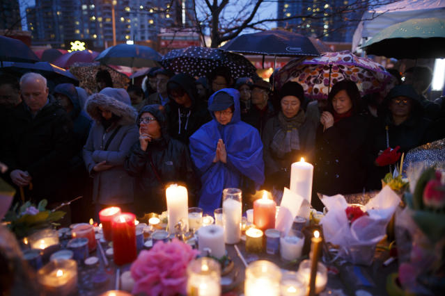 <p>People pray for the victims of the mass killing at a vigil on April 24, 2018 in Toronto, Canada. (Photo: Cole Burston/Getty Images) </p>