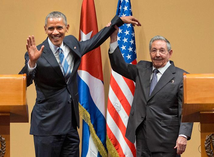 <p>MAR. 21, 2016 — Cuban President Raul Castro lifts up the arm of President Barack Obama at the conclusion of their joint news conference at the Palace of the Revolution in Havana, Cuba. (Pablo Martinez Monsivais/AP) </p>