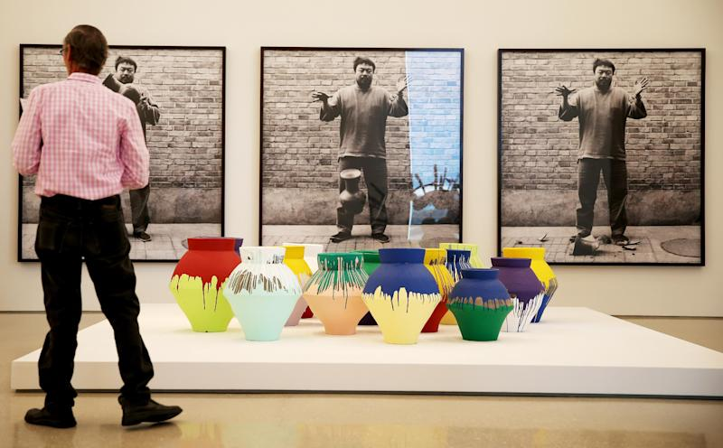 """A museum patron stands near the exhibit by artist Ai Weiwei: """"According To What?"""" at the Perez Art Museum Miami (PAMM) on February 18, 2014 in Miami, Florida"""
