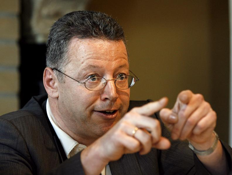 """File - In this March 27, 2010 file picture Markus Beisicht, head of the 'Pro NRW' party attends a press conference in Gelsenkirchen, western Germany. In an operation, police arrested four men overnight Wednesday March 13, 2013, on suspicion of planning to murder the leader of a far-right fringe party known as pro-NRW, Markus Beisicht. Two of them men were arrested in a vehicle near the home of Beisicht in the western city of Leverkusen, police said in a statement. Two other men were arrested when police searched private properties in Essen and Bonn, where a firearm and """"material suitable for the manufacture of explosives"""" were also found. (AP Photo/dpa, Roland Weihrauch,File)"""