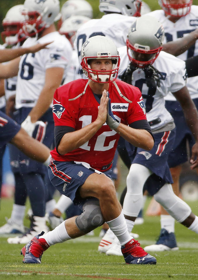 <p>New England Patriots quarterback Tom Brady (12) warms up during an NFL football training camp practice Friday, July 29, 2016, in Foxborough, Mass. (Photo: Michael Dwyer/AP)</p>