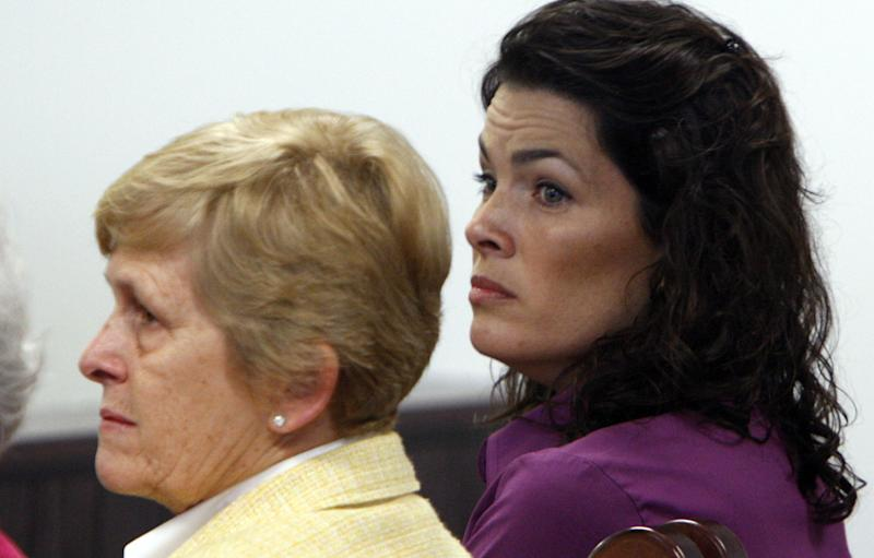 Former Olympic figure skating medalist Nancy Kerrigan, right, sits with her mother, Brenda Kerrigan, in court during the trial of her brother, Mark Kerrigan, at Middlesex District Court on Monday, May 23, 2011, in Woburn, Mass. Mark Kerrigan is charged with manslaughter in the January 2010 death of their father, Daniel Kerrigan. (AP Photo/Bizuayehu Tesfaye, Pool)