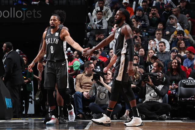 BROOKLYN, NY - DECEMBER 23: Spencer Dinwiddie #8 and DeMarre Carroll #9 of the Brooklyn Nets high-five during a game against the Phoenix Suns on December 23, 2018 at Barclays Center in Brooklyn, New York. (Photo by Nathaniel S. Butler/NBAE via Getty Images)