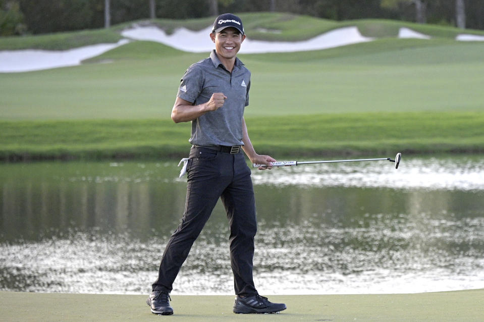 Collin Morikawa celebrates after putting on the 18th green to win the Workday Championship golf tournament Sunday, Feb. 28, 2021, in Bradenton, Fla. (AP Photo/Phelan M. Ebenhack)