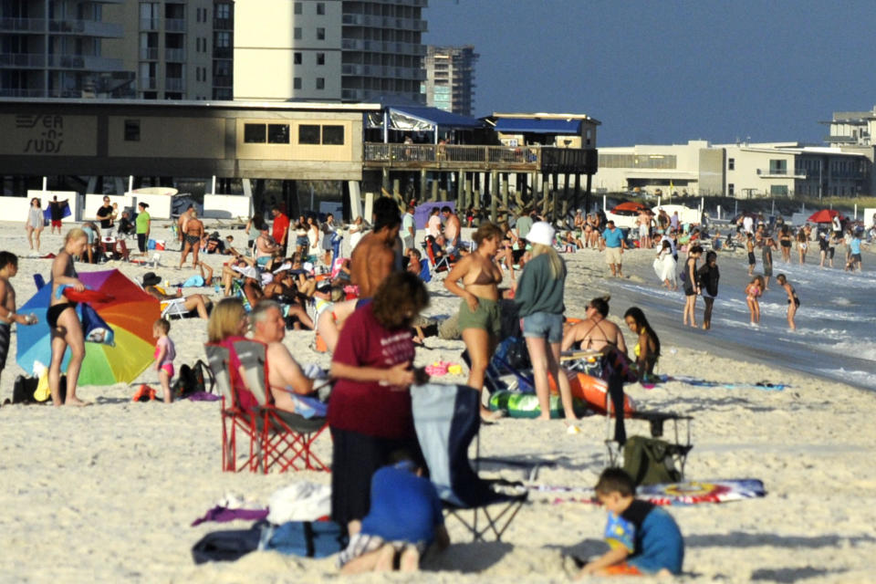 Beachgoers are shown on the coast at Gulf Shores, Alabama. Source: AAP