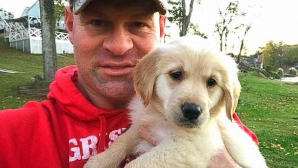 PHOTO: Troy Rogers poses with Clementine, a puppy that was a gift from his high school students. (Courtesy Troy Rogers)