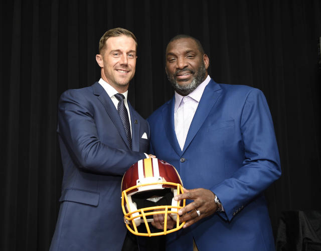 Newly signed Washington Redskins quarterback Alex Smith, left, poses with Doug Williams, the NFL football team's senior vice president of player personnel, during a news conference Thursday, March 15, 2018, in Ashburn, Va. (AP Photo/Nick Wass)