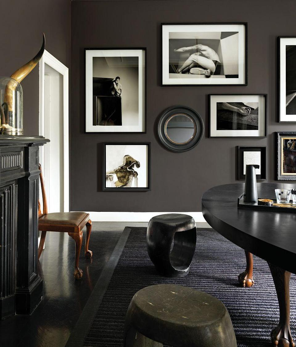 "<p>While espresso-colored walls dominate the dining room in fashion designer <a href=""https://www.elledecor.com/design-decorate/house-interiors/a28482724/designer-neil-barrett-milan-home-tour/"" rel=""nofollow noopener"" target=""_blank"" data-ylk=""slk:Neil Barrett's Milan apartment"" class=""link rapid-noclick-resp"">Neil Barrett's Milan apartment</a>, the bright white moldings and door trim add contrast. </p>"