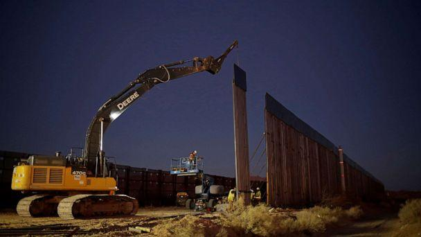 PHOTO: Members of a construction crew using heavy machinery work on a new section of the bollard-type border wall in Sunland Park, N.M., as seen from the Mexican side of the border in Ciudad Juarez, Mexico, Jan. 15, 2021. (Jose Luis Gonzalez/Reuters)