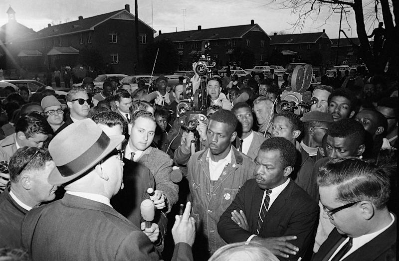 FILE - In this Feb. 23, 1965, file photo, Wilson Baker, left foreground, public safety director, warns of the dangers of night demonstrations at the start of a march in Selma, Ala. Second from right foreground, is John Lewis of the Student Non-Violent Committee. Lewis, who carried the struggle against racial discrimination from Southern battlegrounds of the 1960s to the halls of Congress, died Friday, July 17, 2020. (AP Photo/File)