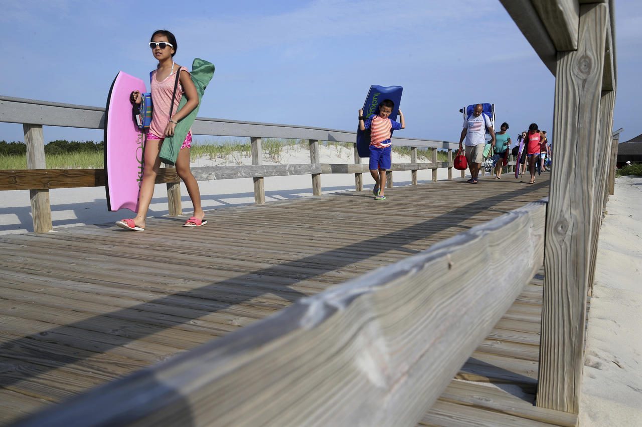<p>People stream onto the beach at Island Beach State Park after it reopened at 8 in the morning Tuesday, July 4, 2017, in Seaside Park, N.J. New Jersey's budget stalemate between Republican Gov. Chris Christie and the Democrat-controlled Legislature had resulted with the state government shut down and state parks closed to the public until late Monday night, just in time for the Fourth of July. (Photo: Mel Evans/AP) </p>