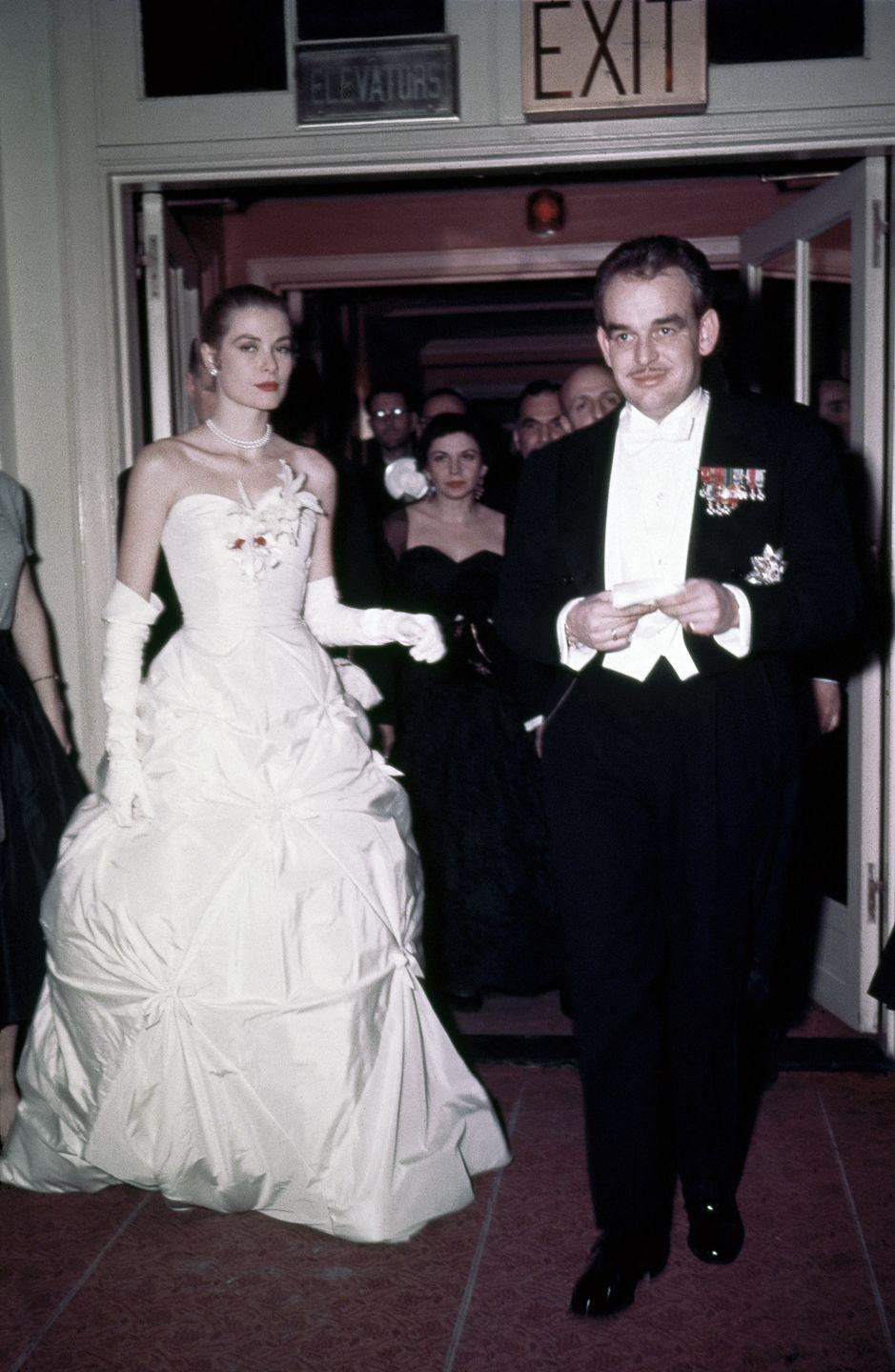 <p>In 1956, Kelly announced her engagement to Prince Rainier III of Monaco. Here, the couple arrives at their engagement party. </p>