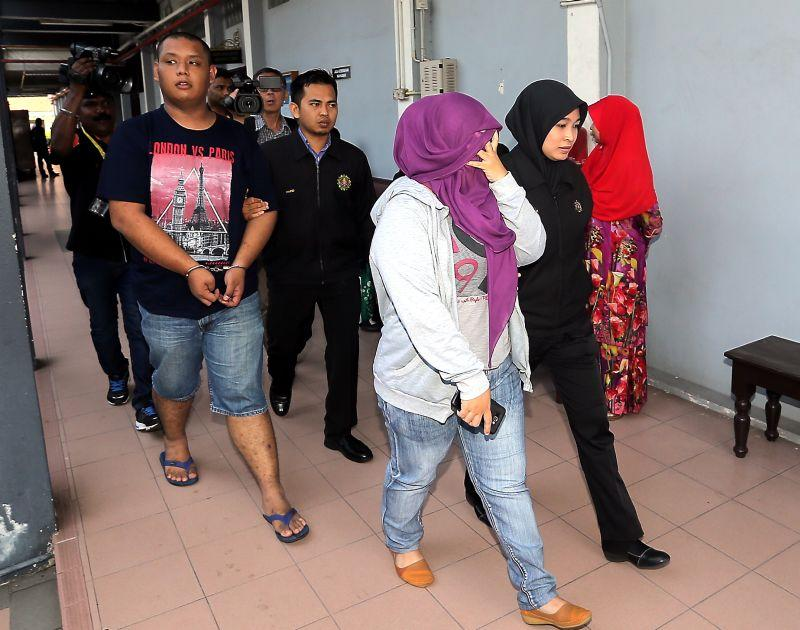 Divorced couple charged with blackmailing man over lewd video