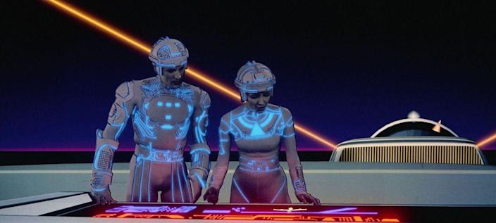 """<p>Jeff Bridges starred in this sci-fi classic about a computer programmer who gets zapped inside of one. (""""Computer fans may very well love it,"""" <a href=""""http://www.nytimes.com/movie/review?res=9500E7DB103BF93AA35754C0A964948260"""" rel=""""nofollow noopener"""" target=""""_blank"""" data-ylk=""""slk:the New York Times"""" class=""""link rapid-noclick-resp"""">the <em>New York Times</em></a> hilariously supposed in its review.) Olivia Wilde and Garrett Hedlund joined Bridges for a follow-up in 2010, <em>Tron: Legacy</em>, and a new roller coaster based on the IP is <a href=""""https://disneyparks.disney.go.com/blog/2017/07/tron-attraction-coming-to-magic-kingdom-park-at-walt-disney-world-resort/"""" rel=""""nofollow noopener"""" target=""""_blank"""" data-ylk=""""slk:coming soon"""" class=""""link rapid-noclick-resp"""">coming soon</a> to Disney World.</p>"""