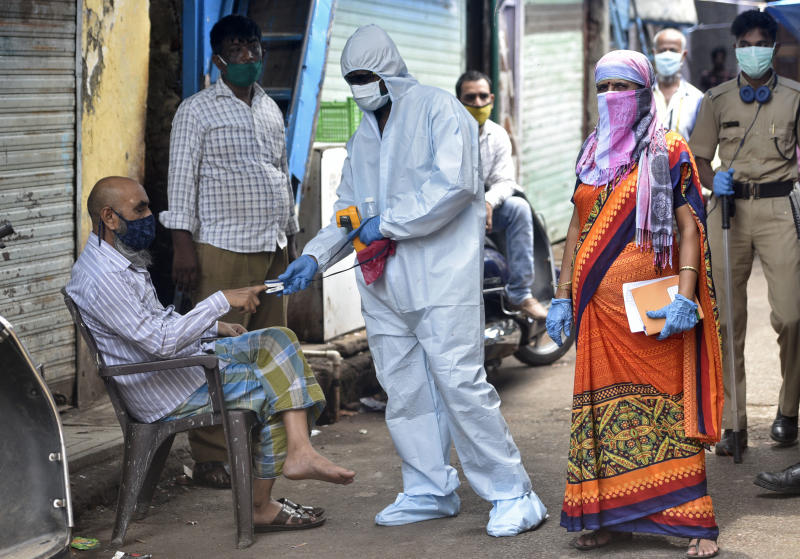 Health workers conducting COVID-19 coronavirus testing drive inside Dharavi Slum , during a government-imposed nationwide lockdown as a preventive measure against the spread of the coronavirus, on June 14, 2020 in Mumbai, India. (Photo by Satyabrata Tripathy/Hindustan Times via Getty Images)