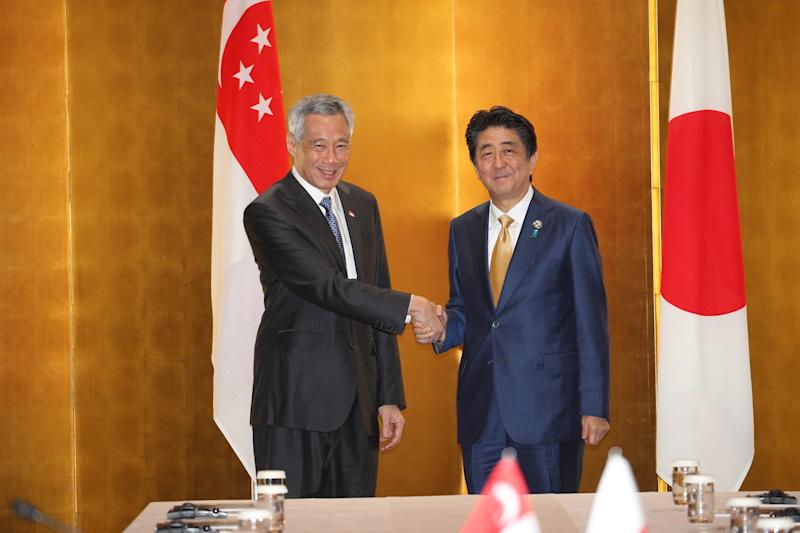 Singapore Prime Minister Lee Hsien Loong and Japanese PM Shinzo Abe meeting at the 2019 G20 Summit in Osaka. (PHOTO: Ministry of Communications and Information)