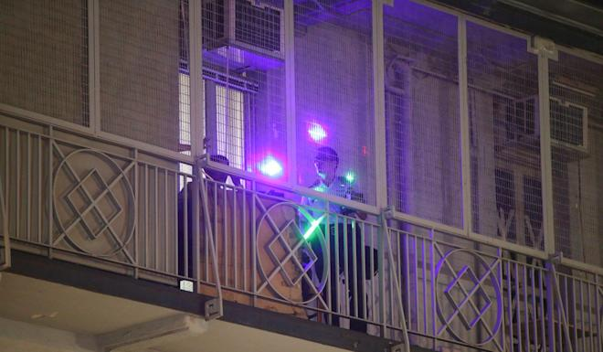 Lasers are pointed at the police station. Photo: Winson Wong