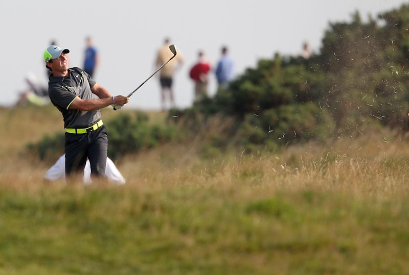 Northern Ireland's Rory McIlroy plays from the rough during his second round 66, on day two of the 2014 British Open at Royal Liverpool in Hoylake, on July 18, 2014