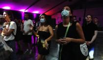 """Attendees wear face masks during the """"00:01"""" event organised by Egyptian Elbows at Oval Space nightclub, as England lifted most coronavirus disease (COVID-19) restrictions at midnight, in London"""