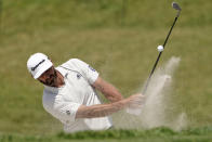 Dustin Johnson hits onto the 11th green from the bunker during a practice round of the U.S. Open Golf Championship, Tuesday, June 15, 2021, at Torrey Pines Golf Course in San Diego. (AP Photo/Jae C. Hong)