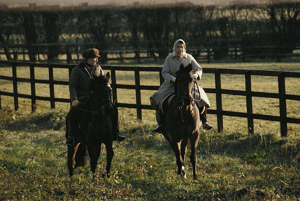 <p>Princess Anne and Queen Elizabeth II go for a horse ride on the grounds of the Sandringham estate. </p>