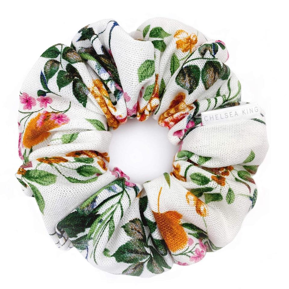"""<p><strong>Chelsea King</strong></p><p>chelseaking.shop</p><p><strong>$17.98</strong></p><p><a href=""""https://chelseaking.shop/collections/all-products/products/linen-wildflower-scrunchie"""" rel=""""nofollow noopener"""" target=""""_blank"""" data-ylk=""""slk:Shop Now"""" class=""""link rapid-noclick-resp"""">Shop Now</a></p><p>Remember those scrunchies I talked about? Here's a cute floral one to add to your wrist party. </p>"""