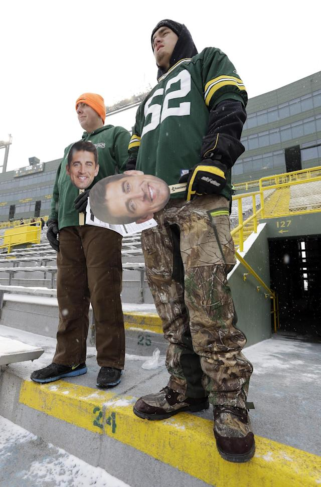 Brad Bauer, left, and Jake Hoernke arrive at Lambeau Field before an NFL football game between the Green Bay Packers and the Atlanta Falcons Sunday, Dec. 8, 2013, in Green Bay, Wis. (AP Photo/Mike Roemer)