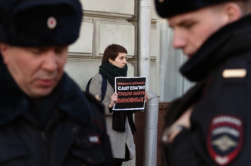 A human rights activist pickets the presidential administration headquarters in Moscow, on March 10, 2016