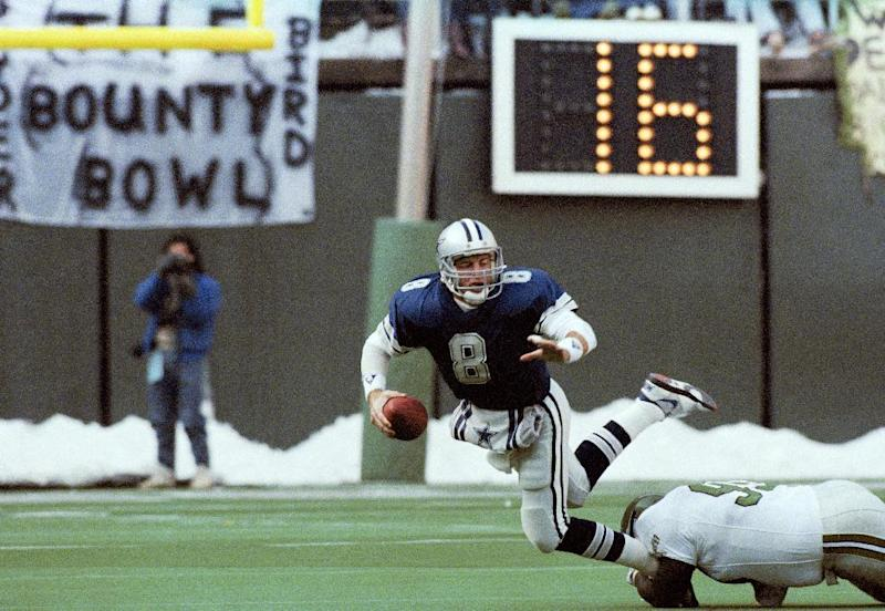 """** FILE ** In this Dec. 10, 1989, file photo, Dallas Cowboys' quarterback Troy Aikman is unable to get a pass off as he is tackled by Philadelphia Eagles' Reggie White during the first half of NFL football game in Philadelphia. The Eagles-Cowboys game on Thanksgiving in 1989 was known as the """"bounty bowl"""", when a Cowboys player said the Eagles had bounties out on Troy Aikman. (AP Photo/Brad Bower)"""