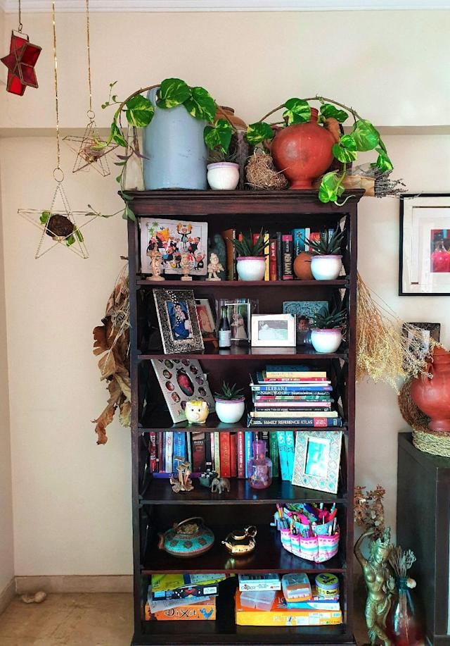 """My bookshelves are not just for books! I love collecting bits and bobs from all over. Old pickle jars and terracotta pots a personal favourite."""
