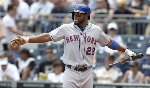 New York Mets' Eric Young Jr. (22) warms up before batting in the first inning of the baseball game on Sunday, June 29, 2014, in Pittsburgh. (AP Photo/Keith Srakocic)