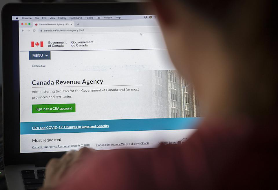 A person looks at a Canada Revenue Agency homepage in Montreal on Aug. 16, 2020. (Photo: Graham Hughes/The Canadian Press)